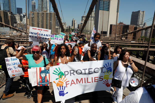 Signs from protests in cities across U.S. over immigration policy