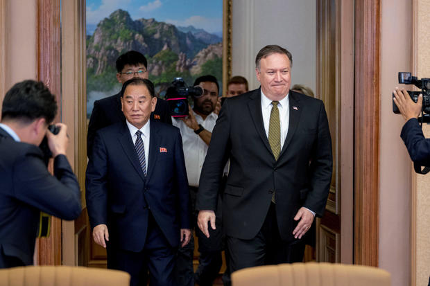 U.S. Secretary of State Mike Pompeo and Kim Yong Chol, a North Korean senior ruling party official and former intelligence chief, return to discussions after a break at Park Hwa Guest House in Pyongyang