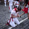 A runner prays before the bull run on the fourth day of the San Fermin festival in Pamplona