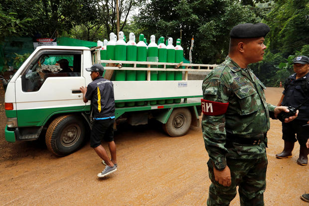 A truck carrying oxygen tanks arrives outside the Tham Luang cave complex, where 12 schoolboys and their soccer coach were trapped inside a flooded cave, in the northern province of Chiang Rai, Thailand, July 8, 2018.