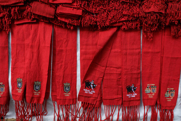Red waistbands are displayed for sale two days before the start of the annual San Fermin bull-running festival in Pamplona