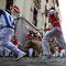 Revellers sprint in front of bulls during the fifth running of the bulls of the San Fermin festival in Pamplona