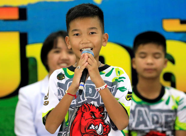 Chanin Vibul Rungruang, 11, introduces himself during the news conference in Chiang Rai