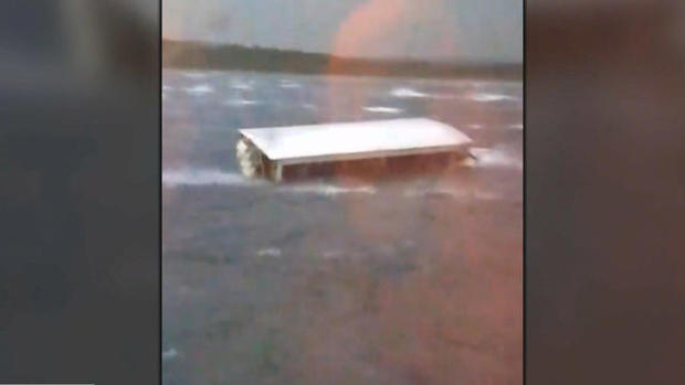 A duck boat is seen sinking during rough weather in Table Rock Lake in the Branson area of Missouri in a screen capture from video on July 19, 2018.