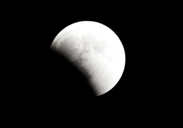 "A ""Super Blue Blood Moon"" rises during a lunar eclipse over Cairo"