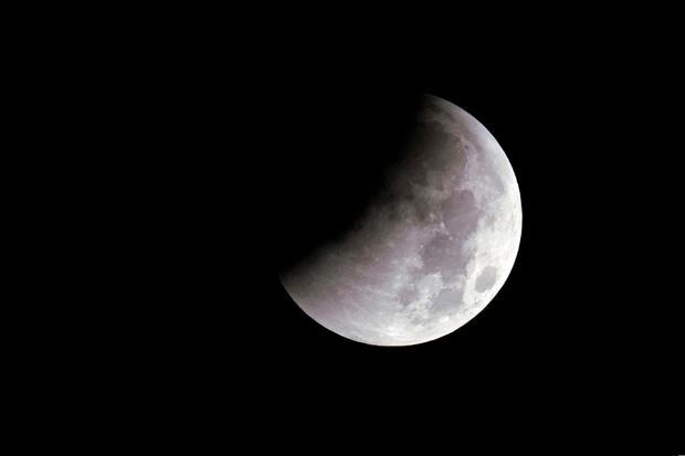 """Super Blue Blood Moon"" is seen during a lunar eclipse over Shanghai"