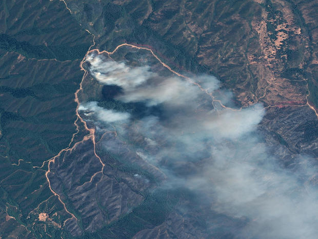 A satellite image shows the River fire at the Mendocino Complex wildfire in California