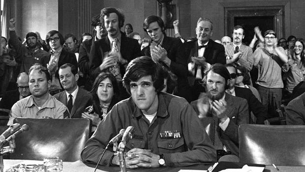 "John Kerry, 27, testifies about the war in Vietnam before the Senate Foreign Relations Committee in Washington, April 22, 1971. Sen. Kerry, D-Mass., 63, became a prominent critic of the war after he came home as a decorated veteran, famously asking lawmakers at the hearing: ""How do you ask a man to be the last man to die for a mistake?"" Kerry opposes sending additional troops into Iraq. (AP Photo/Henry Griffin)"