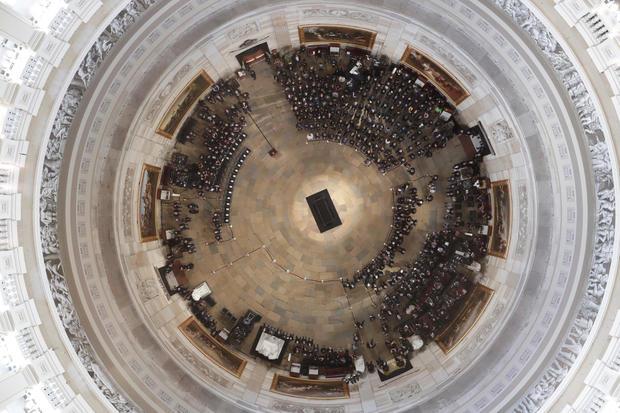 People await the arrival of the casket of U.S. Senator John McCain in the U.S. Capitol Rotunda in Washington