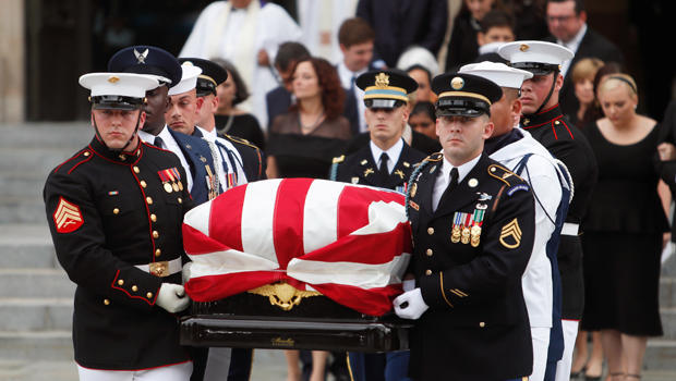 An Honor Guard carries the casket of the late Senator John McCain from the Washington National Cathedral in Washington