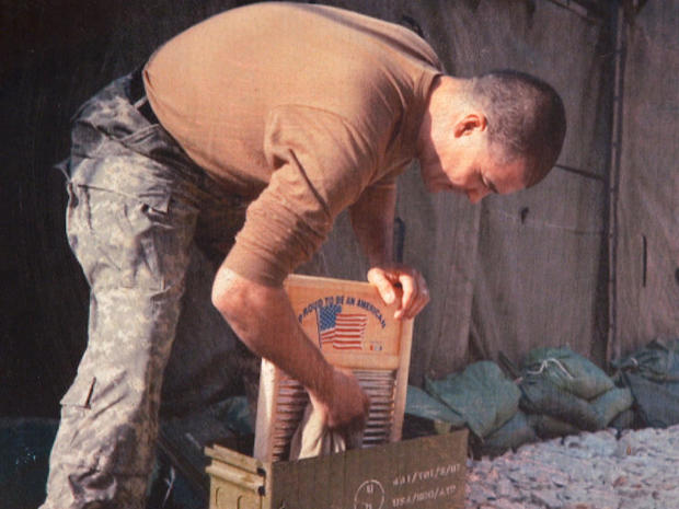 washboards-servicemember-washes-clothes-promo.jpg