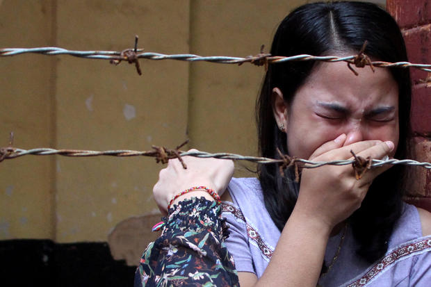 Wife of Reuters journalist Kyaw Soe Oo reacts after listening to the the verdict at Insein court in Yangon
