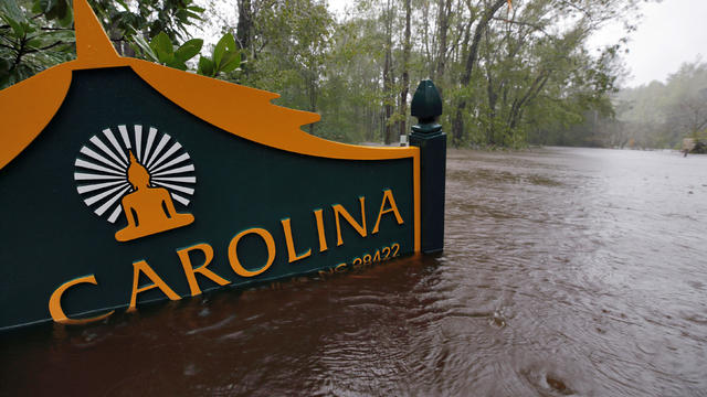 A sign for the Buddhist Association of North Carolina is partially submerged as waters rise after Hurricane Florence swept through in North Carolina
