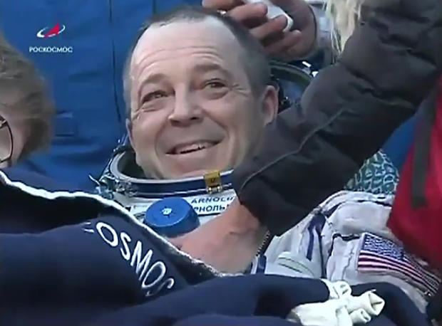 Three astronauts land safely on Earth after six months in space