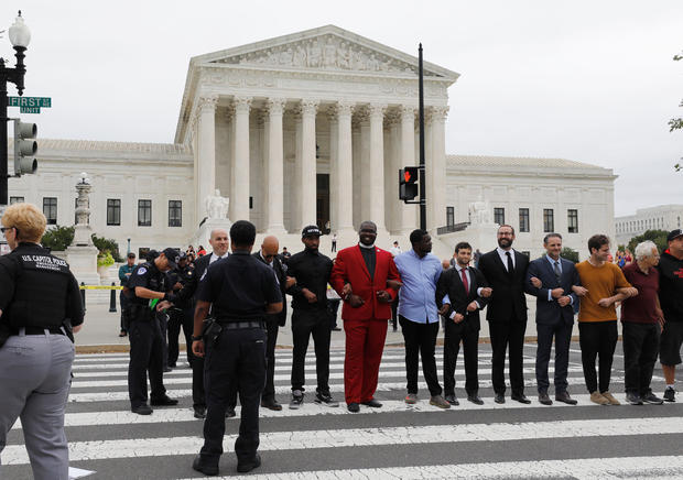 Protestors are arrested for blocking street in front of U.S. Supreme Court while demonstrating against confirmation of Supreme Court nominee Kavanaugh on Capitol Hill in Washington