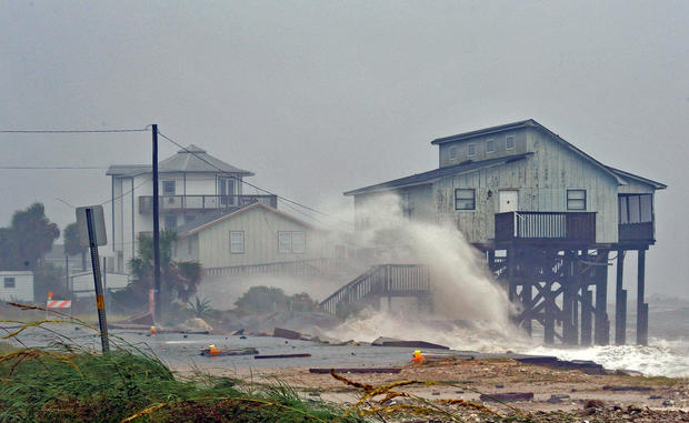 Waves crash on stilt houses along the shore due to Hurricane Michael at Alligator Point in Franklin County