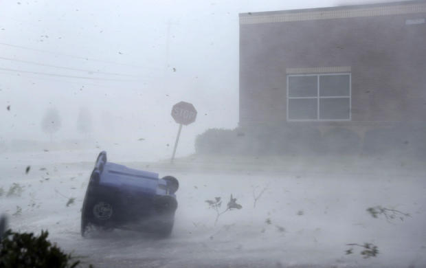 A trash can and debris are blown down a street by Hurricane Michael on Oct. 10, 2018, in Panama City, Florida. The hurricane made landfall on the Florida Panhandle as a Category 4 storm.