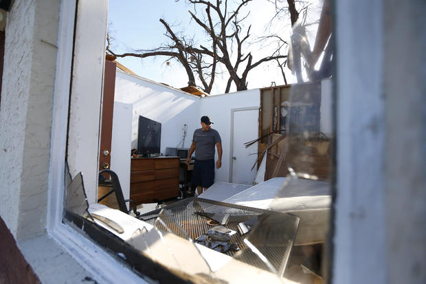 Carlos Pamias inspects his residence damaged by Hurricane Michael in Parker, Florida