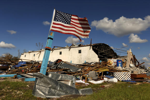 A U.S. flag flies in front of a building damaged by Hurricane Michael in Panama City, Florida, Oct. 11, 2018.