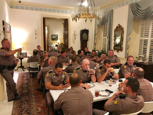 Florida state troopers dine at the governor's mansion in Tallahassee on Oct. 11, 2018.