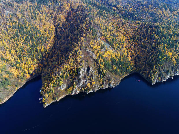 An aerial view shows the autumn foliage on the banks of the Yenisei River in the Siberian taiga outside Krasnoyarsk