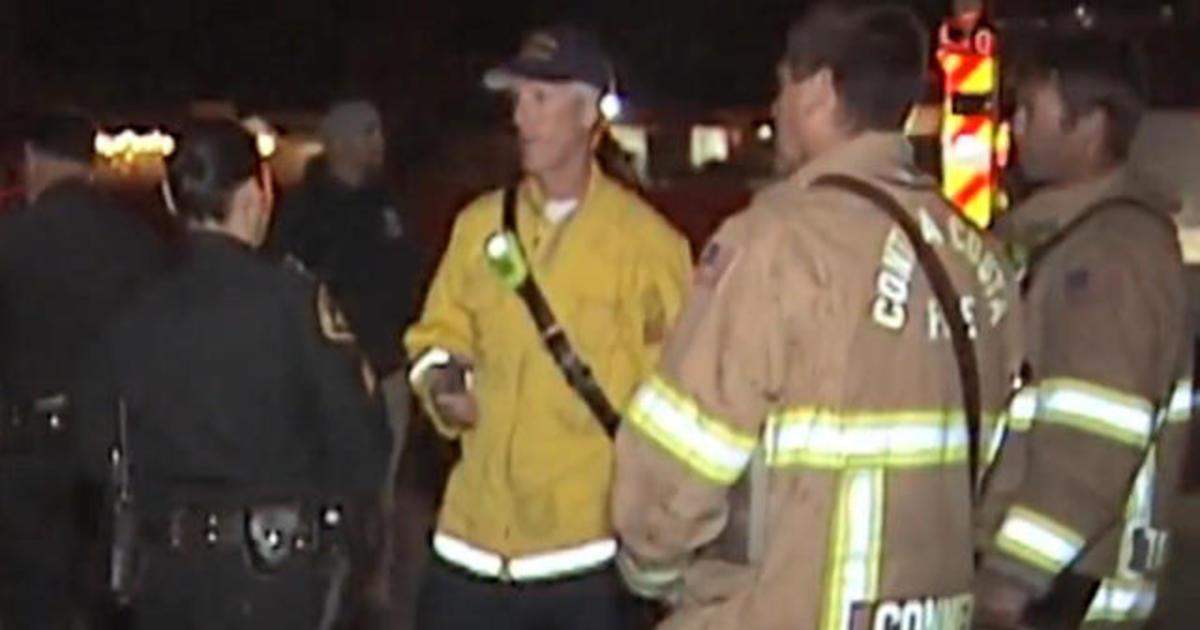 Thousands evacuate as grass fire threatens natural gas line