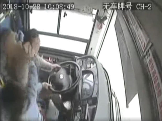 woman-passenger-battles-with-bus-driver-in-china-before-bus-plunges-off-bridge-102818.jpg