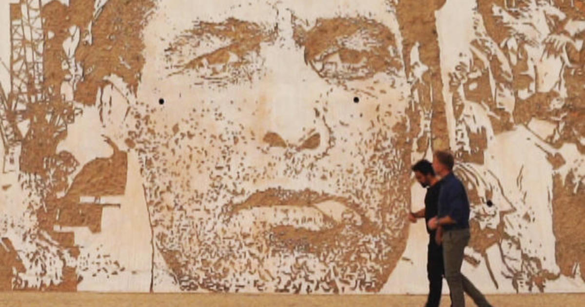 Lisbon street artist Vhils: Scraping and carving art into cityscapes