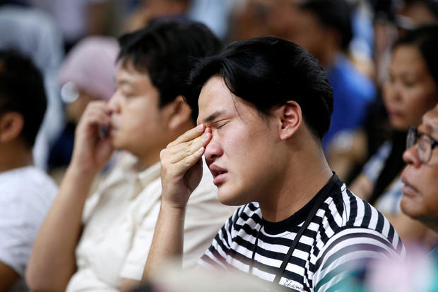 A man who had family on the crashed Lion Air flight cries as he attends a news conference about the recovery process at a hotel in Jakarta, Indonesia, Nov. 5, 2018.
