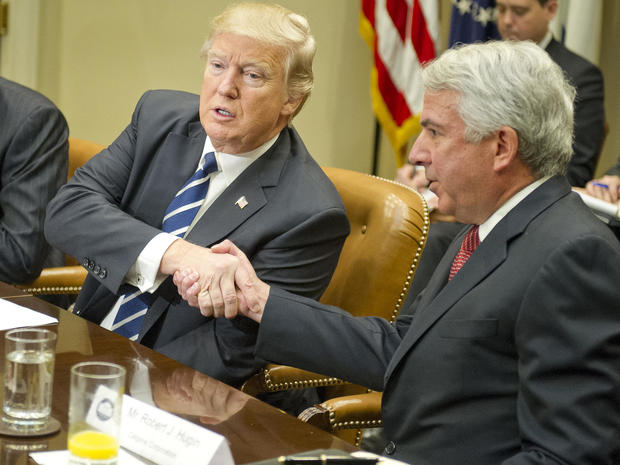 President Trump shakes hands with Bob Hugin, executive chairman of the Celgene Corporation, as he meets with representatives from PhRMA, the Pharmaceutical Research and Manufacturers of America, in the Roosevelt Room of the White House on Jan. 31, 2017, in Washington.