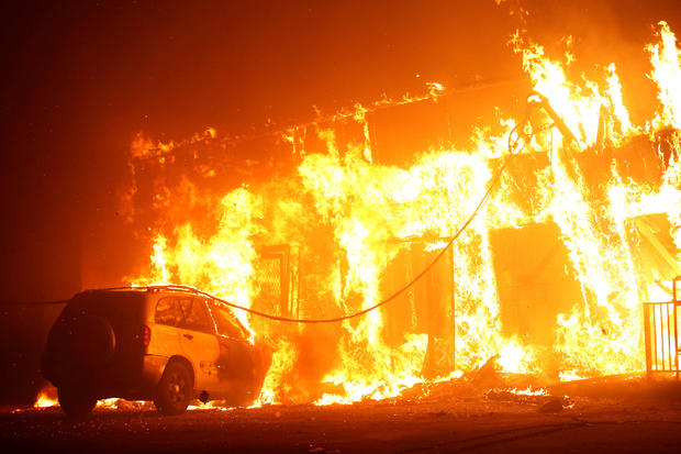 """A structure is seen engulfed in flames during the so-called """"Camp Fire"""" in Paradise, California, Nov. 8, 2018."""