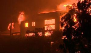 Calif. homes in ruins as wildfires rage on