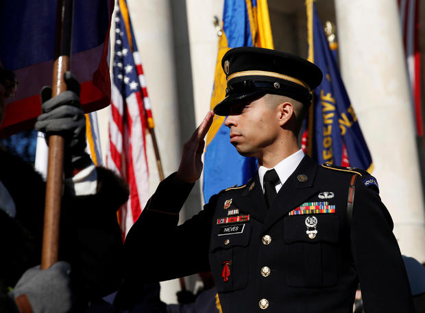 A soldier salutes during ceremonies on Veteran's Day at Arlington National Cemetery in Arlington