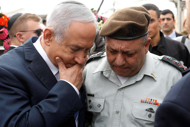 Israeli Prime Minister Benjamin Netanyahu chats with Israeli Chief of Staff Lieutenant-General Gadi Eizenkot as they attend an annual state memorial ceremony for Israel's first prime minister, David Ben Gurion, at his gravesite in Sde Boker