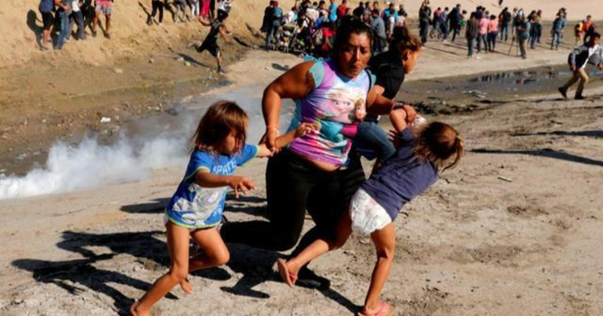 Story behind photo of mom and children running away from tear gas