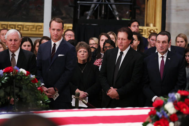 U.S. sports figures stand by the flag-draped casket of former U.S. President George H.W. Bush in Washington