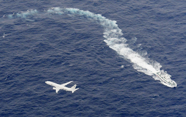 A Japan Coast Guard patrol vessel and U.S. Navy airplane conduct search and rescue operation at the area where two U.S. Marine Corps aircraft have been involved in a mishap in the skies, off the coast of Kochi prefecture
