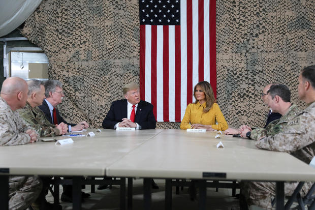 U.S. President Trump meets political and military leaders during an unannounced visit to Al Asad Air Base