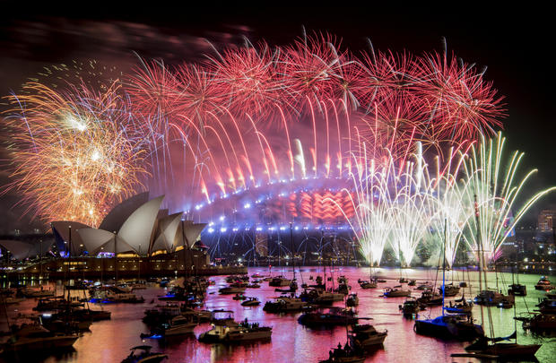 Fireworks explode over the Sydney Harbour during New Year's Eve celebrations in Sydney