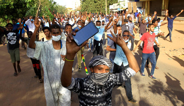 FILE PHOTO: Sudanese demonstrators chant slogans as they march along the street during anti-government protests in Khartoum