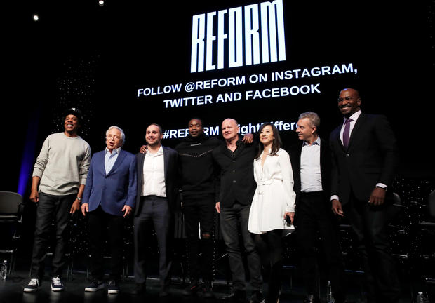 """The founding partners of """"Reform Alliance"""" a newly formed organization to reform the U.S. criminal justice system pose together in New York"""