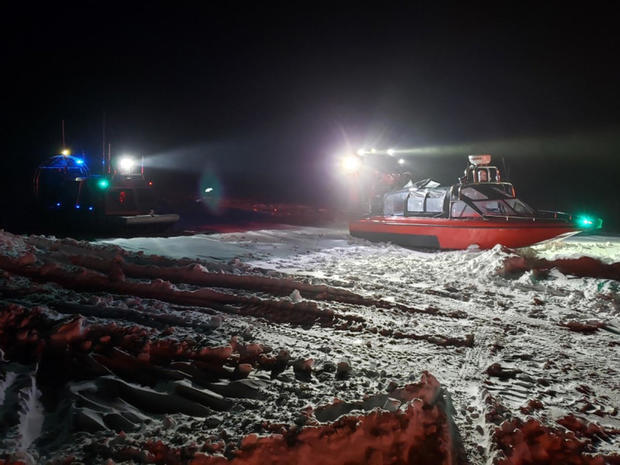 Crews from the Coast Guard and Wisconsin Department of Natural Resources respond to seven people stranded on iced-over water near Sturgeon Bay, Wisconsin, Jan. 29, 2019.