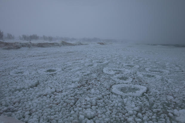 Frozen Lake Michigan is pictured in St. Joseph, Michigan