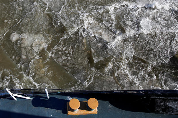 Ice is seen along the Hudson river between the towns of Kingston and Poughkeepsie while U.S. Coast Guard members work on a boat used as an ice breaker during a polar vortex in New York