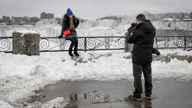 Boiling water freezes as it is thrown during subzero temperatures carried by the polar vortex in Chicago