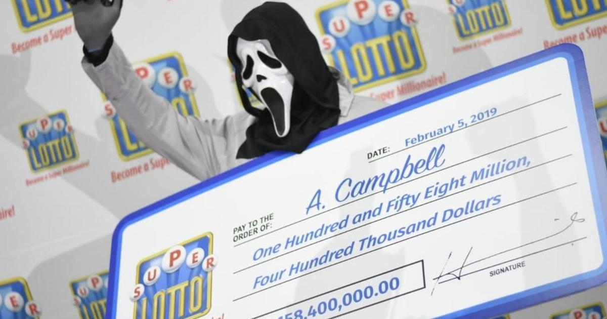 Lottery winner claims prize in