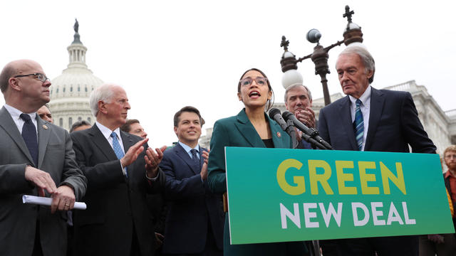 "U.S. Representative Ocasio-Cortez  and Senator Markey hold a news conference for their proposed ""Green New Deal"" to achieve net-zero greenhouse gas emissions in 10 years, at the U.S. Capitol in Washington"