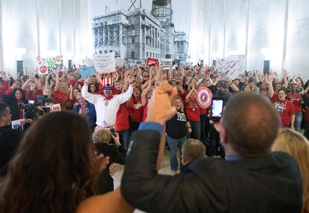 Striking teachers celebrate as lawmakers reject a bill that would have opened the first charter schools in the state, in Charleston