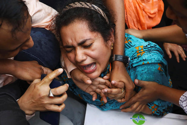 One of the relatives of victims of a fire incident mourns outside Dhaka Medical College Hospital in Dhaka, Bangladesh