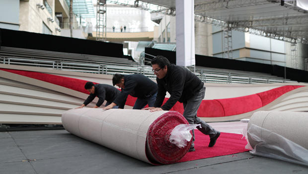 Workers roll out the Oscars red carpet as preparations continue for the 91st Academy Awards in Hollywood, Los Angeles